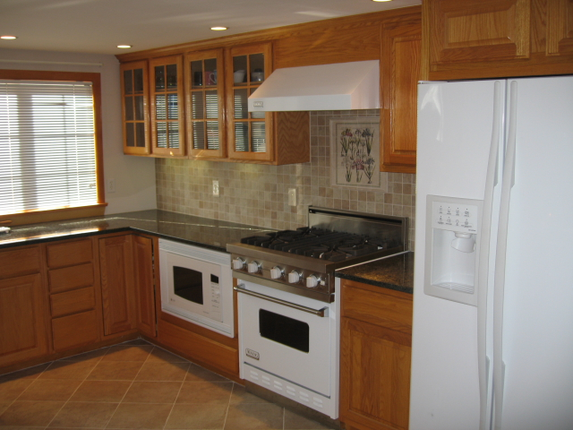 Wenham General Contractor, Paul G. Wonson Construction, replacement windows, renovations, custom carpentry, kitchen and bath remodeling, general contractor, gutters, seamless gutters, construction
